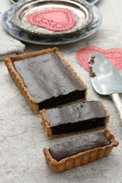 A decadent and easy chocolate tart recipe that tastes delicious warm or at room temperature.