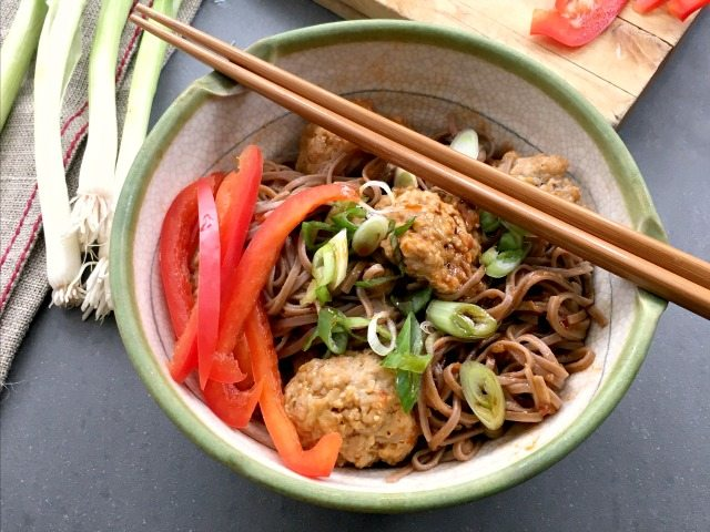 Korean turkey meatballs are highly seasoned with fresh ginger, garlic, sesame oil and a little molasses. Once cooked they're tossed with simply spiced noodles that are seasoned with gochujang.