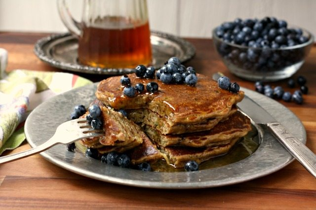 Whole wheat zucchini pancakes are hearty and wholesome and include one serving of vegetables in each portion.