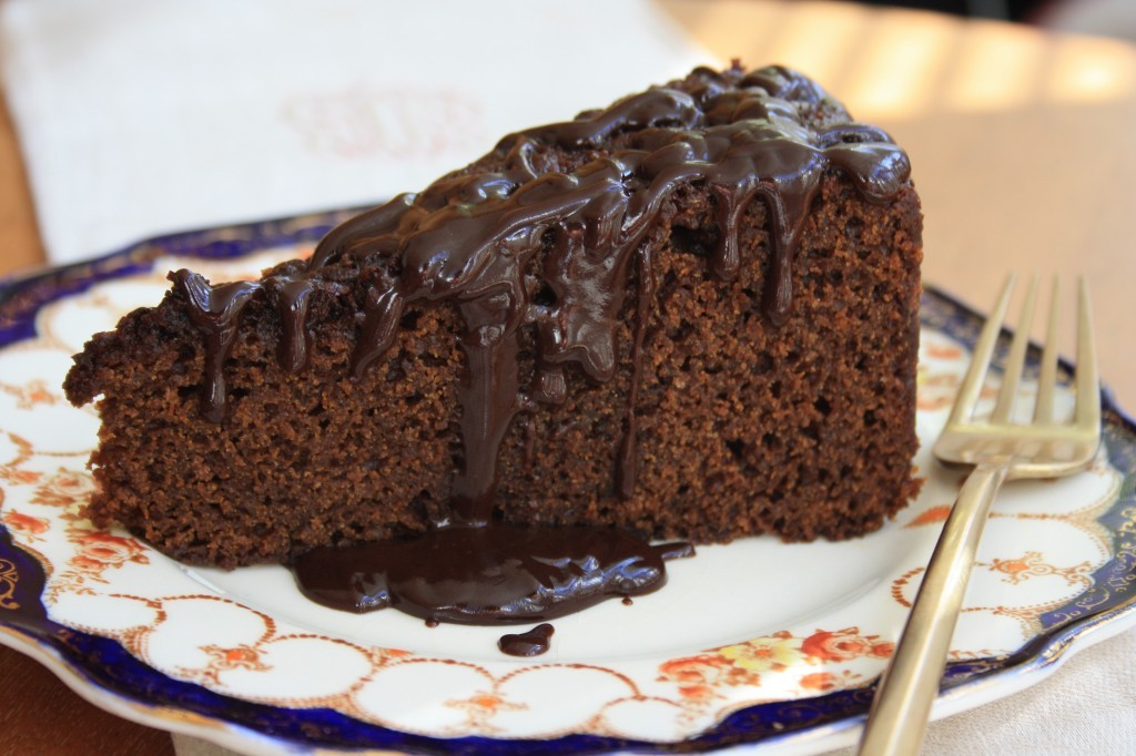 Espresso molasses cake with chocolate sauce is dense and fudgy.