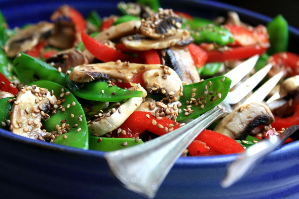 Snow pea and red pepper salad with walnut dressing pretty on a buffet table and so delicious