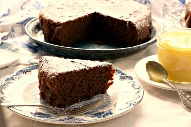 Easy hot water gingerbread is quick to mix up and makes a great snack cake. Or you can dress it up with lemon curd.