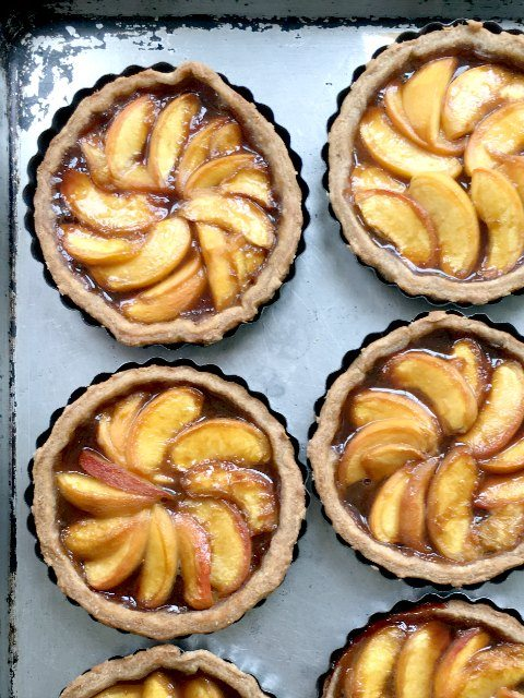 Molasses peach tarts are especially delicious - like a mouthful of summer in every bite. And you can't beat the texture. Flaky pastry and tender peaches sweetened only with a bit of honey and molasses. These aren't drippy either so the pastry doesn't go soggy.