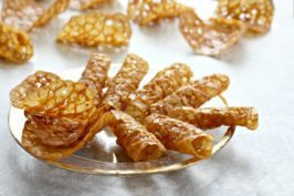 Easy Molasses Almond Tuiles - A festive golden cookie that's lacy and crisp.