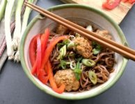 Korean meatballs are highly seasoned with fresh ginger, garlic, sesame oil and a little molasses. Once cooked they're tossed with simply spiced noodles. Serve with raw or lightly sauteed peppers for a bright and flavourful meal.
