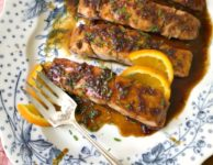 Garlicky orange juice salmon recipe: Molasses, orange and soy sauce is an excellent flavour combination for salmon. Since it's a rich tasting fish salmon can handle the extra flavour of the molasses-soy glaze. A little honey helps to round out the sweetness and garlic adds a nice flavour punch.