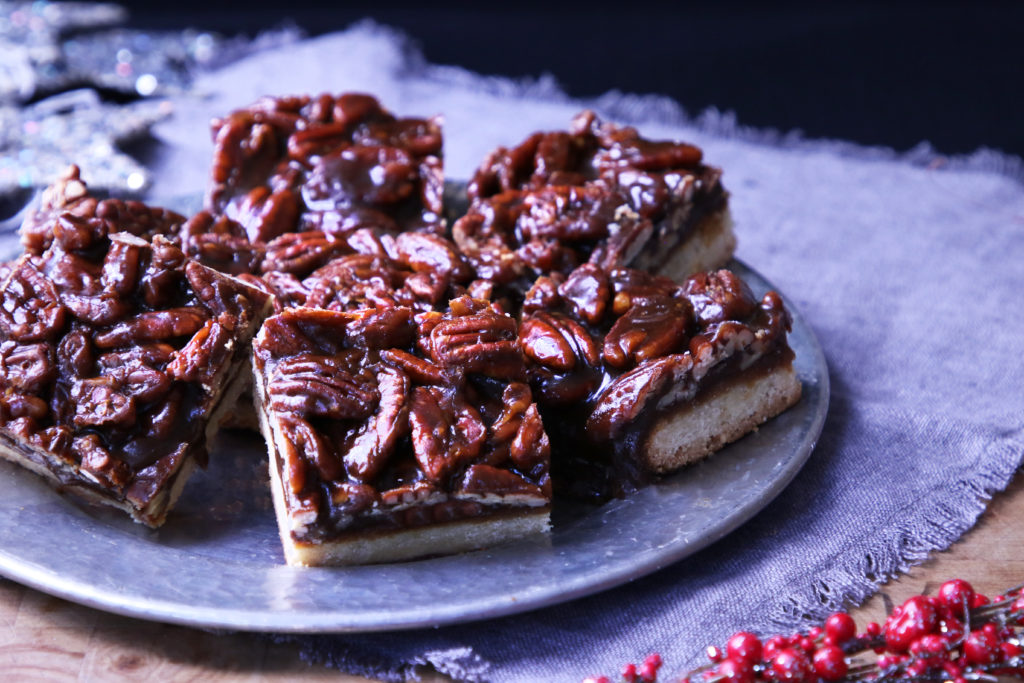 Glossy pecan toffee bars... buttery toffee thick with pecans layered on a barely-sweet shortbread base. They're gorgeous but not over the top. They're festive and beyond delicious.
