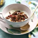 Easy chocolate granola is a sweet addition to your morning yogurt. Refined sugar free.