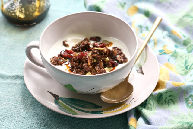 Healthy chocolate granola is a sweet addition to your morning yogurt. Refined sugar free.
